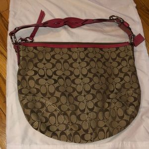 Coach bag with coach pattern.